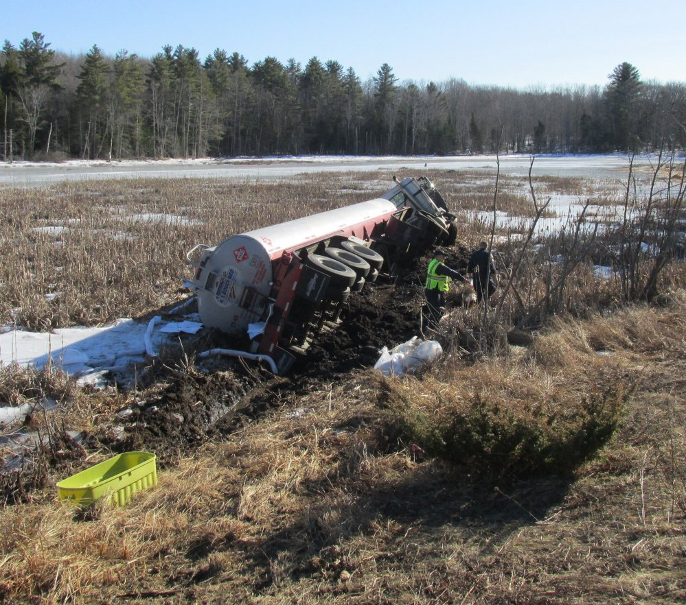 A Maine State Police photo shows an overturned oil tanker truck that collided with a car on Route 3 in Liberty on Monday.