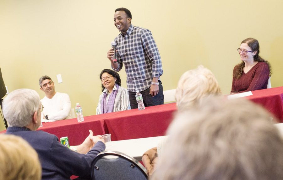 Somali immigrant Abdi Iftin speaks about learning English from Arnold Schwarzenegger movies and misconceptions he had about the United States before arriving 2   years ago during a panel discussion with Iraqi refugee Nawar Al Obaidi, left, and Cambodian refugee Makara Meng, second from left, led by the Holocaust and Human Rights Center of Maine Executive Director Elizabeth Helitzer, right, Monday in Augusta.