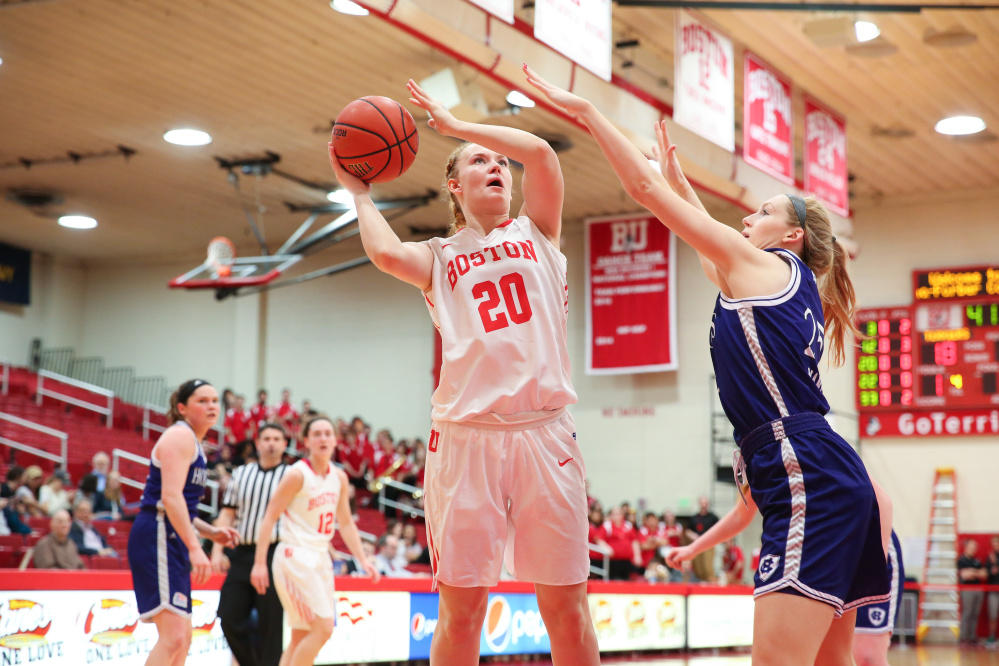 Boston University freshman Nia Irving goes up for a shot as Holy Cross freshman Lauren Manis defends during a Feb. 25 game in Boston.