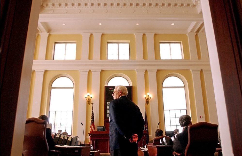 Robert Crockett watches over proceedings at the State House in Augusta in 2004, when he served as the Maine Senate's sergeant-at-arms.