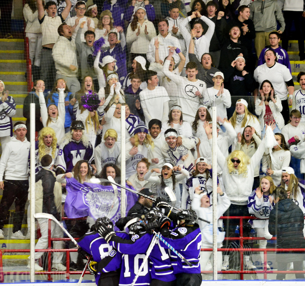 The Waterville hockey team and its fans celebrate a late goal during the Class B state championship game against York on Saturday in Lewiston.