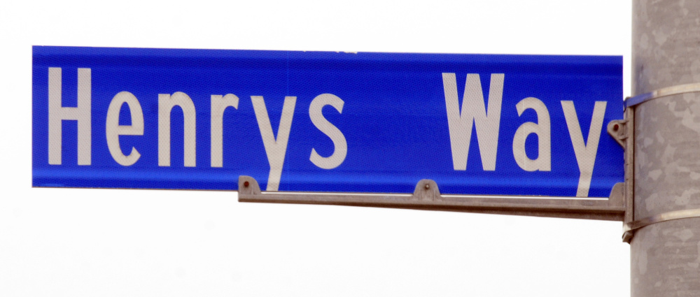 This photo taken Friday shows the Henrys Way road sign across Old Belgrade Road from MaineGeneral Medical Center in north Augusta.