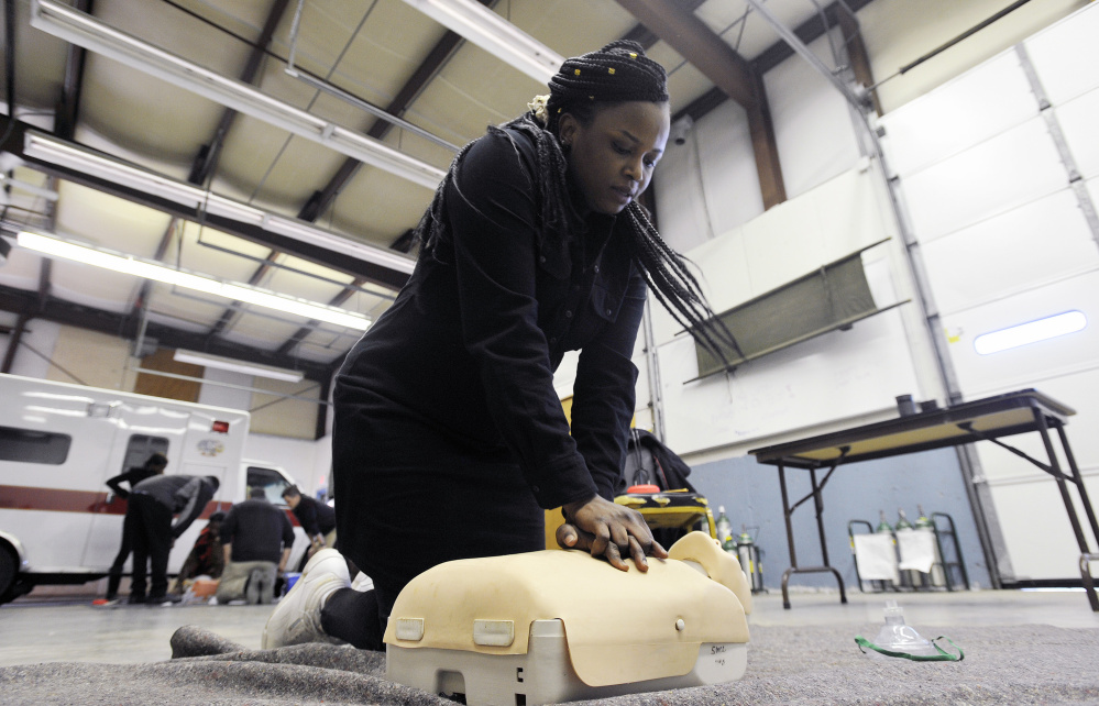 Jolly Ntirumenyerwa of Portland, originally from the Democratic Republic of Congo, performs CPR on a training mannequin at SMCC. Ntirumenyerwa is taking part in a new program at SMCC that focuses on training immigrants to become EMTs.