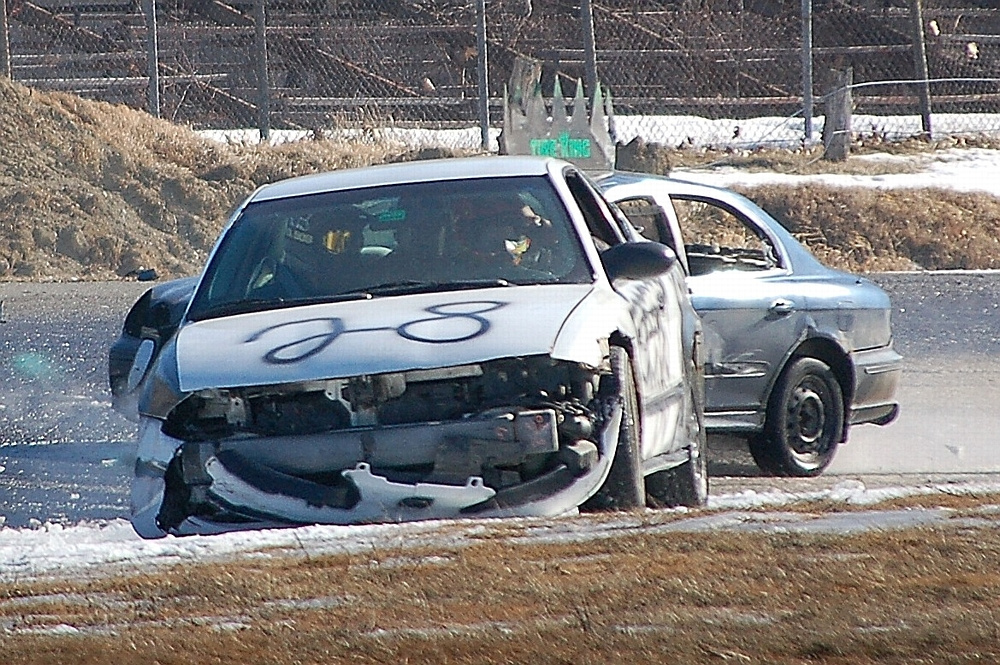 Cars get tangled up during a Snowbowl Enduro 100 race at Unity Raceway on March 5.