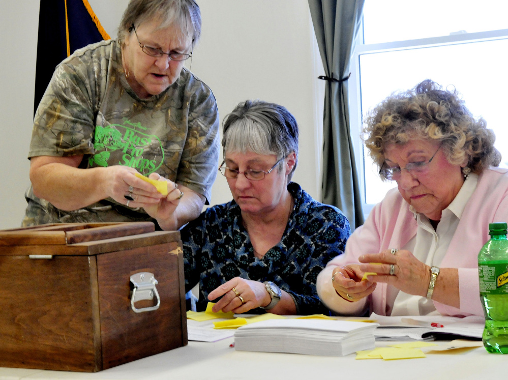 Thorndike ballot clerks Donna Smith, left, Lucille Gardiner and LouAnn Cranouski stayed busy counting ballots during the annual town meeting on Saturday.
