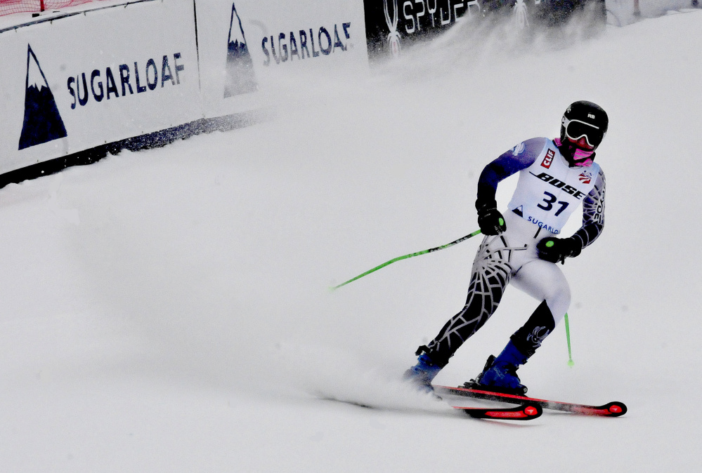 Colby College freshman Sandra Schoepke comes to a stop after finishing her race Monday at the U.S. Alpine Championships on Monday at Sugarloaf Mountain.