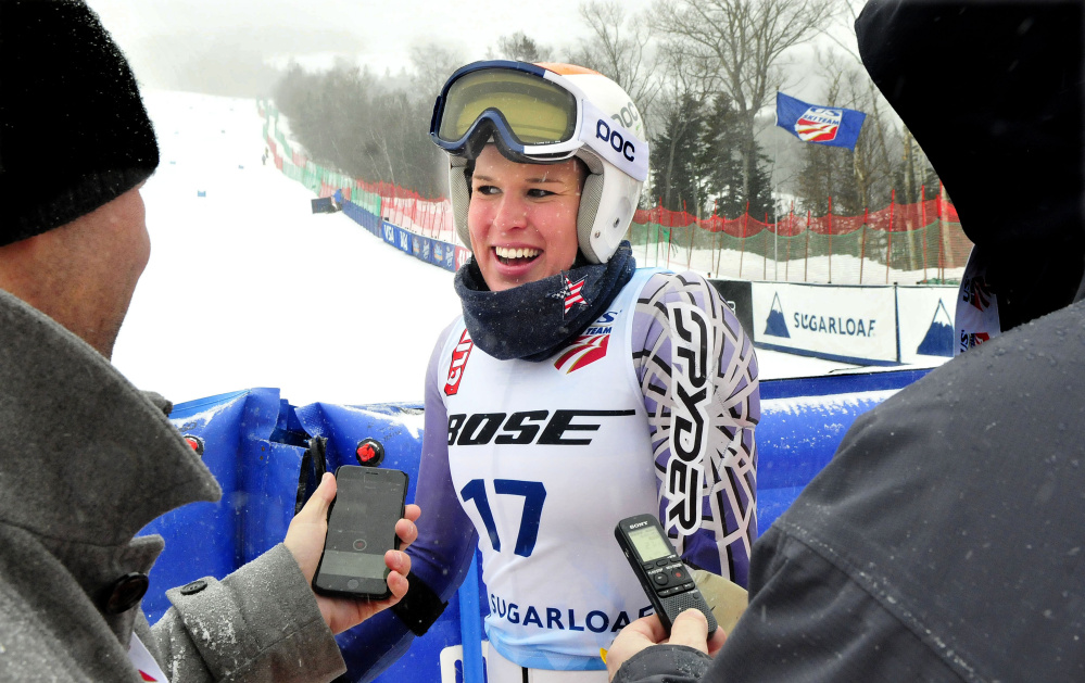 Colby College captain Mardi Haskell speaks with the media after her women's giant slalom run during the U.S. Alpine Championships on Monday at Sugarloaf Mountain.