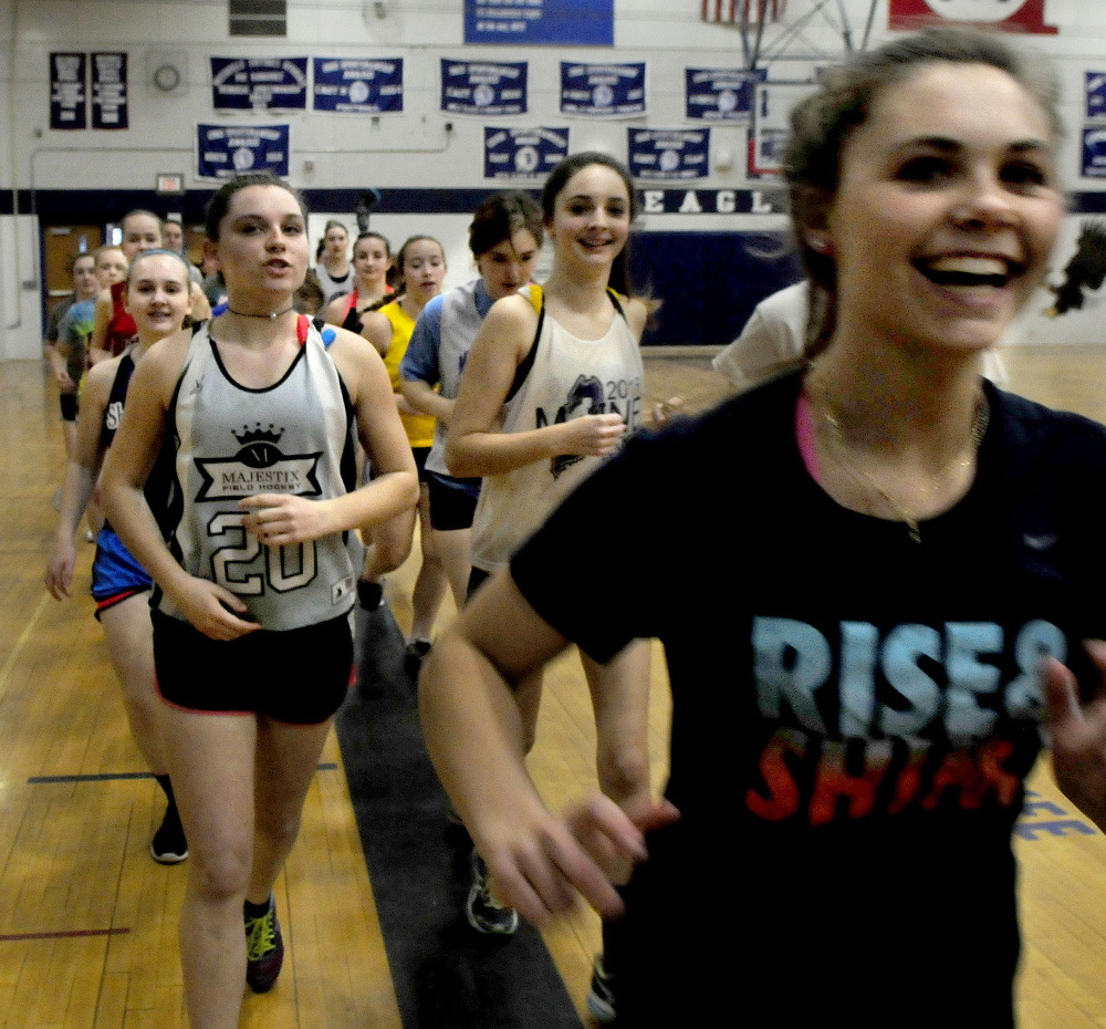 Messalonskee girls lacrosse players run during practice Wednesday at the high school.