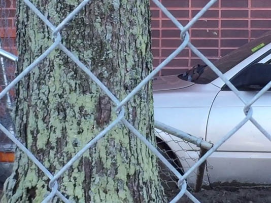 A driver lost control of his car and crashed through a fence surrounding a synagogue work site in Portland on Wednesday.