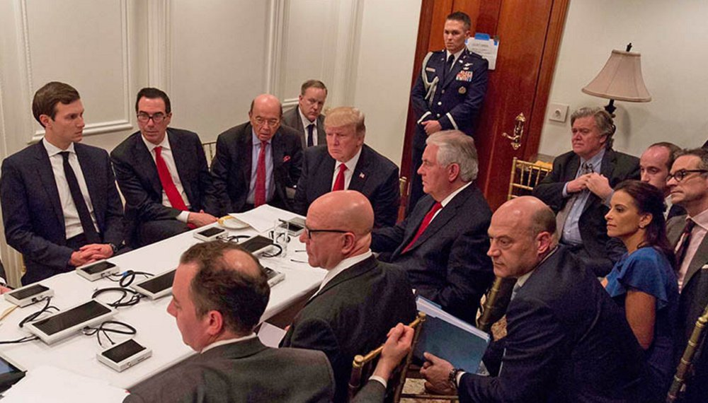 President Trump and his national security team are briefed via videoconference by Gen. Joseph Dunford, chairman of the Joint Chiefs of Staff, on the missile strike on Syria. The meeting was held in the Sensitive Compartmented Information Facility at Trump's Mar-a-Lago resort in Florida. White House Press Secretary Sean Spicer said the image was digitally edited for security purposes.