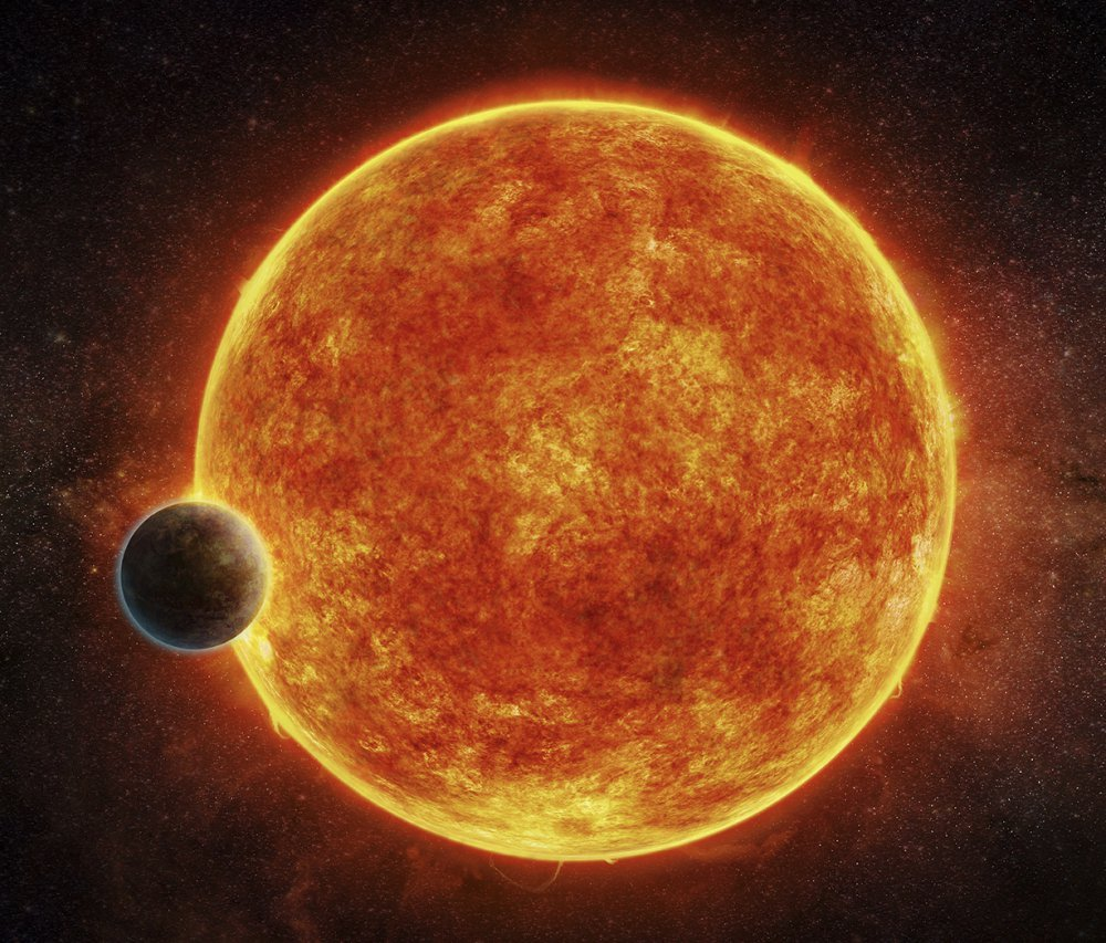 This artist's rendering depicts LHS 1140b, a newly discovered rocky planet in the habitable zone for life, surrounding its small, faint red host star.