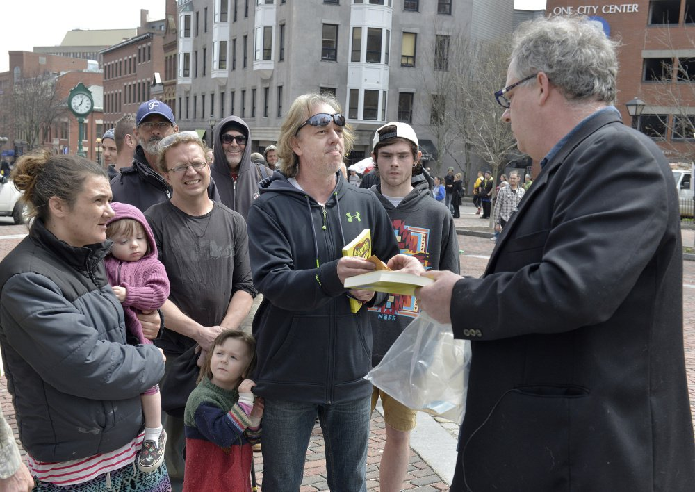 AT LEFT: Crash Barry attracts fans with his 1-gram pot packets Thursday, including Victor Smith of Westbrook.