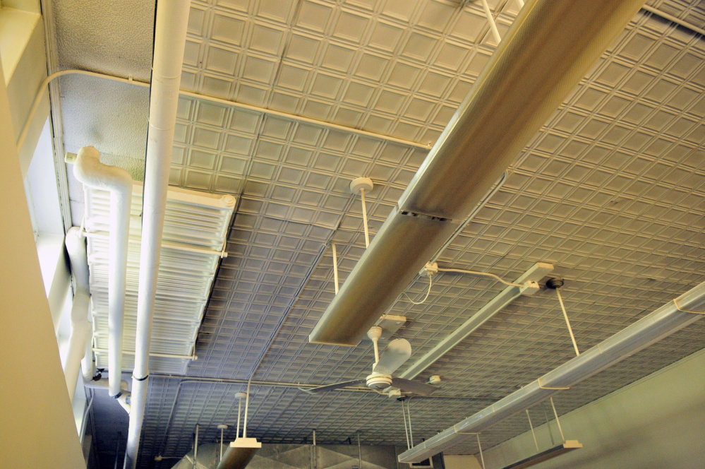 Original pressed metal ceilings in the Central Building are seen during a tour on Oct. 7, 2016, at Stevens Commons in Hallowell.
