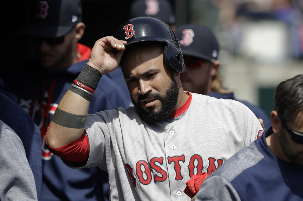 Boston's Sandy Leon enters the dugout after scoring from third on a single by Marco Hernandez during the second inning against the Detroit Tigers on Sunday in Detroit. Leon also had the game-winning hit in the eighth inning.