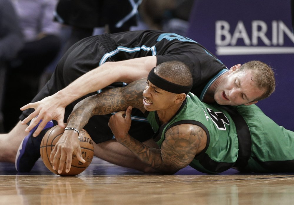 Charlotte Hornets forward Cody Zeller, top, and Boston Celtics guard Isaiah Thomas vie for a loose ball in the second half of a game in Charlotte, North Carolina last Saturday.