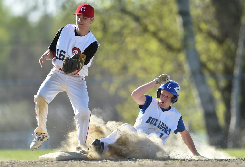 Lawrence baserunner Devon Webb slides safely into second base ahead of the throw to Cony's Kolbe Merfeld during a Kennebec Valley Athletic Conference Class A game last season in Fairfield.