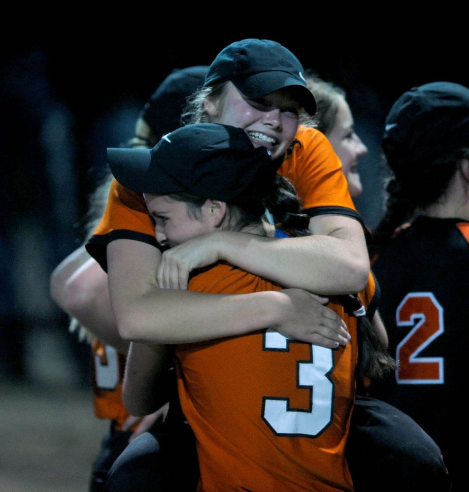 A North champs: Members of the Skowhegan softball team celebrate after they defeated Edward Little 8-2 in the Class A North title game last season in Augusta.