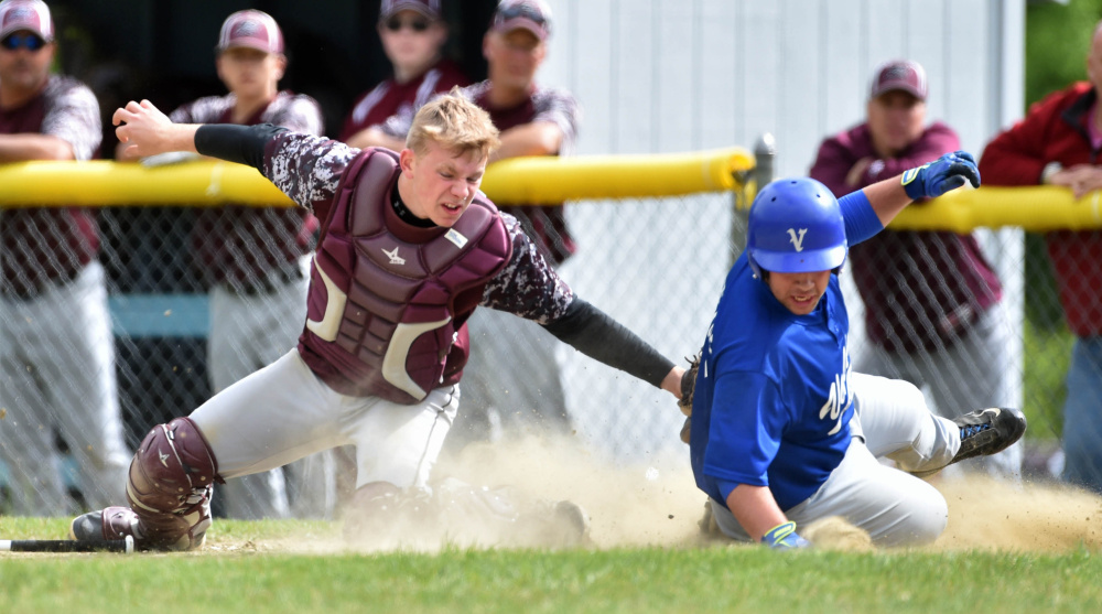Richmond catcher Brendan Emmons tries unsuccessfully to tag out Valley runner Brandon Thomas during a Class D South semifinal last season. Emmons and the Bobcats return a talented team that should contend for a conference crown again.