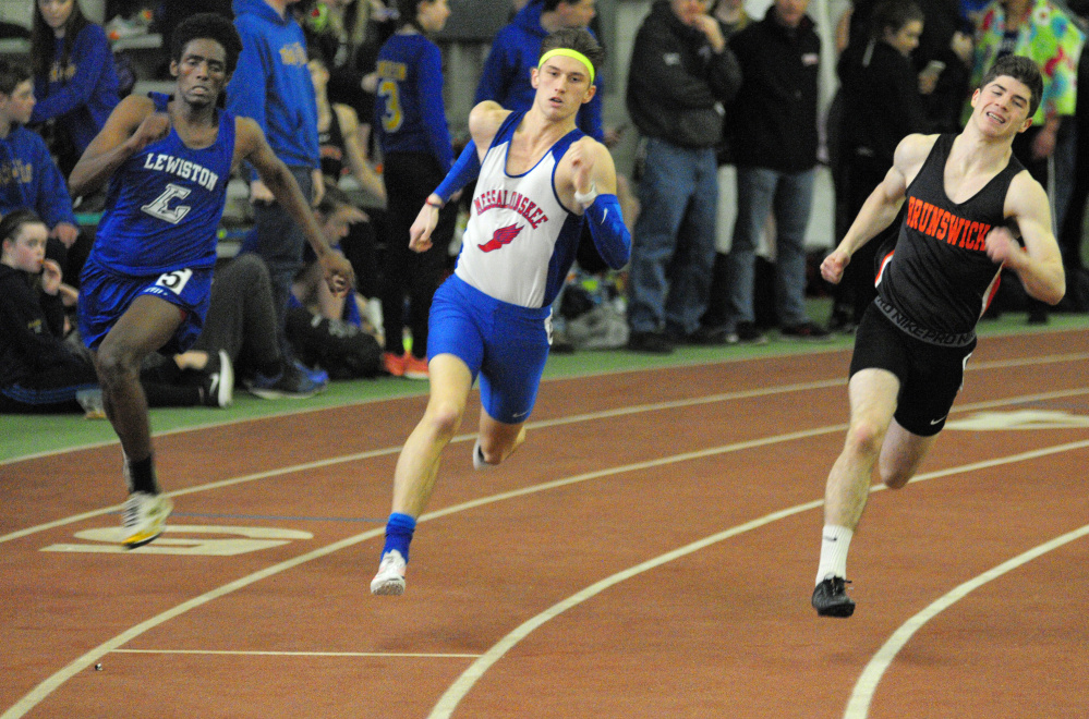 Lewiston's Abdirashid Abukar, left, Messalonskee's Tanner Burton, center, and Brunswick's Seth White head for the finish line during the 200-meter sprint at the Kennebec Valley Athletic Conference indoor track and field championships this season at Bowdoin College in Brunswick.