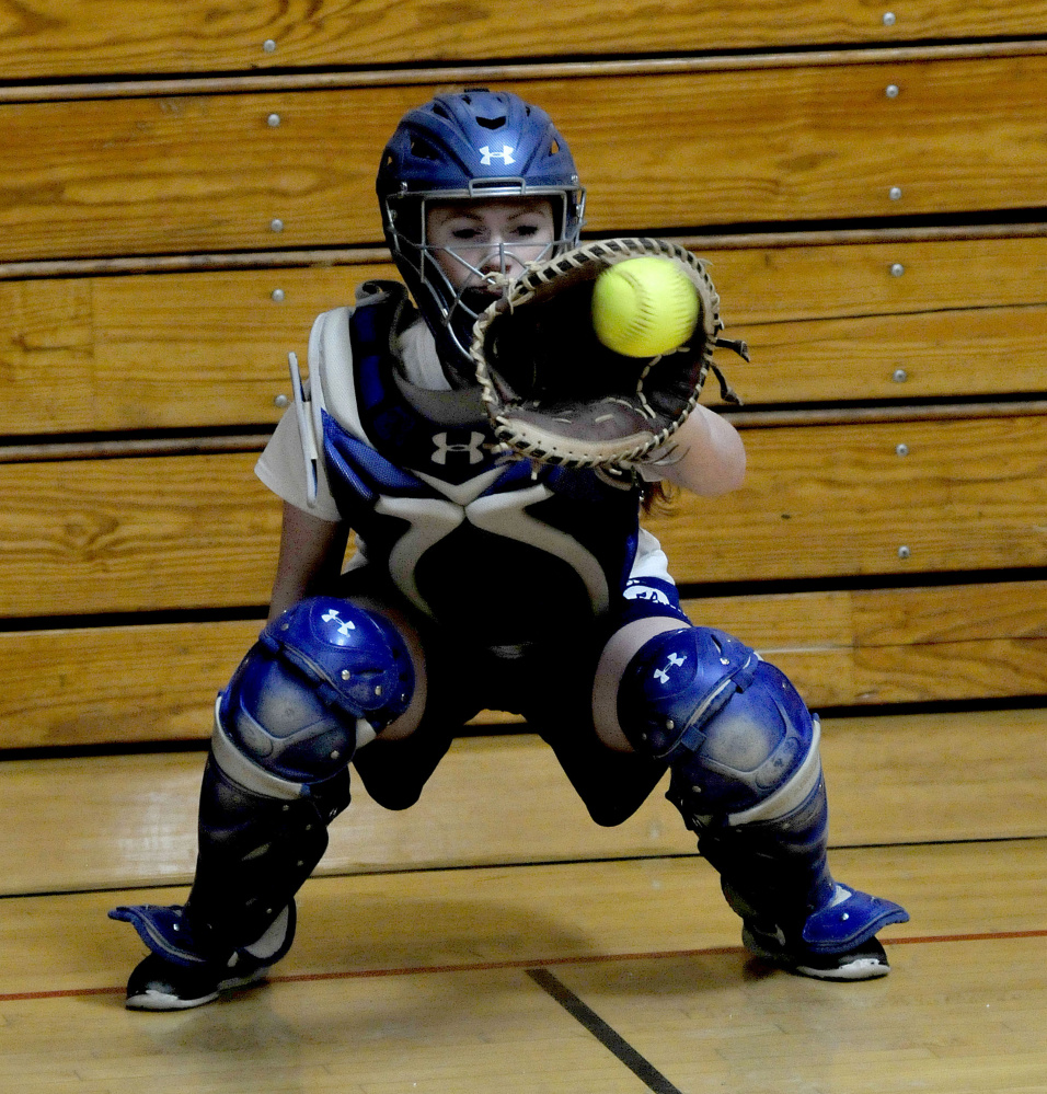 Madison junior Ashley Emery gets some work in behind the plate earlier this spring. Emery is moving from second base to the high-profile catching position for the reigning Class C state champions.