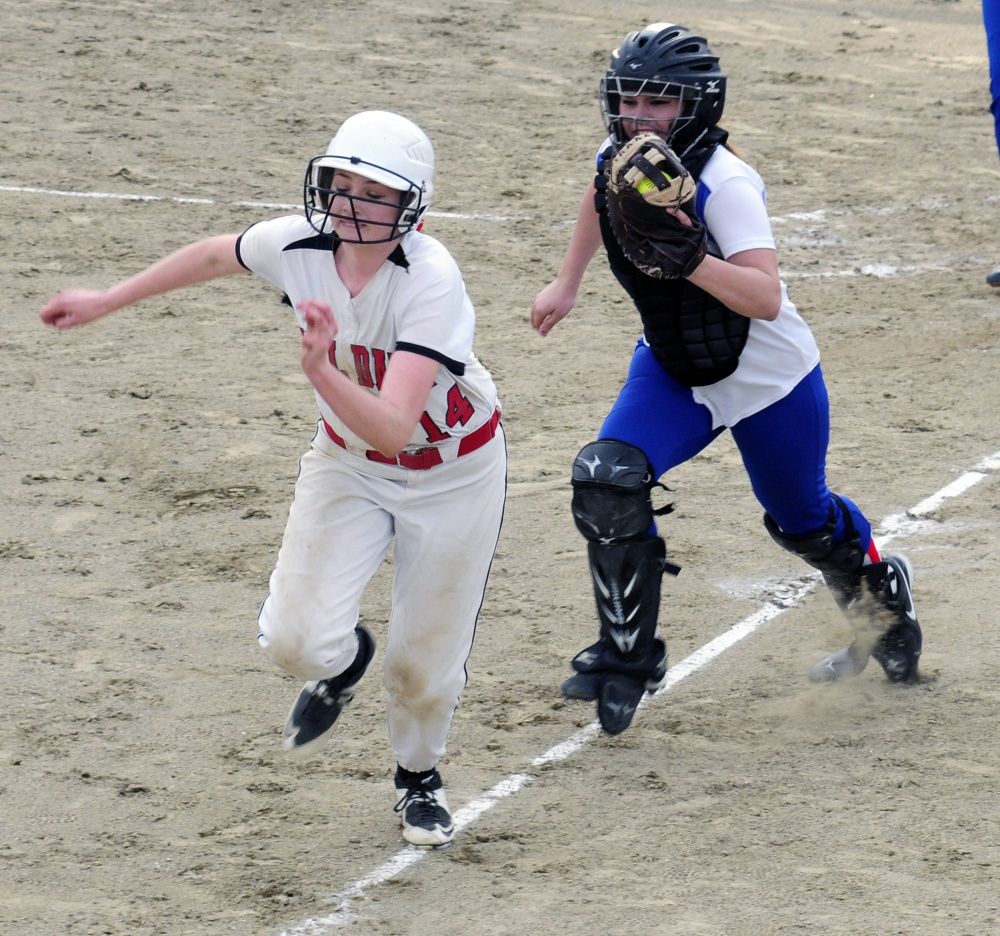 Hall-Dale baserunner Kayla Johnson tries to get back to third but can't outrun Oak Hill catcher Emma Hlister during a Mountain Valley Conference game last season. Hlister is one of the area's best catchers, and she's put in the offseason work to get to that point.
