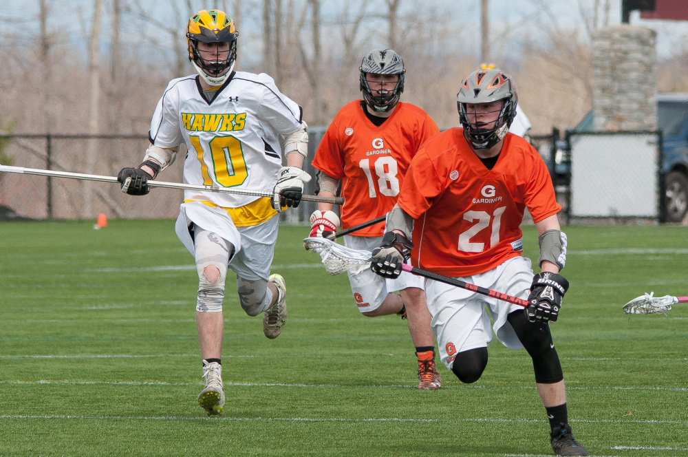 Maranacook/Winthrop sophomore midfielder Alex Nuce, left, tries to chase after Gardiner's Sloan Berthiaume (21) and Parker Hinkley during a Kennebec Valley Athletic Conference Class B game Tuesday morning at Kents Hill.