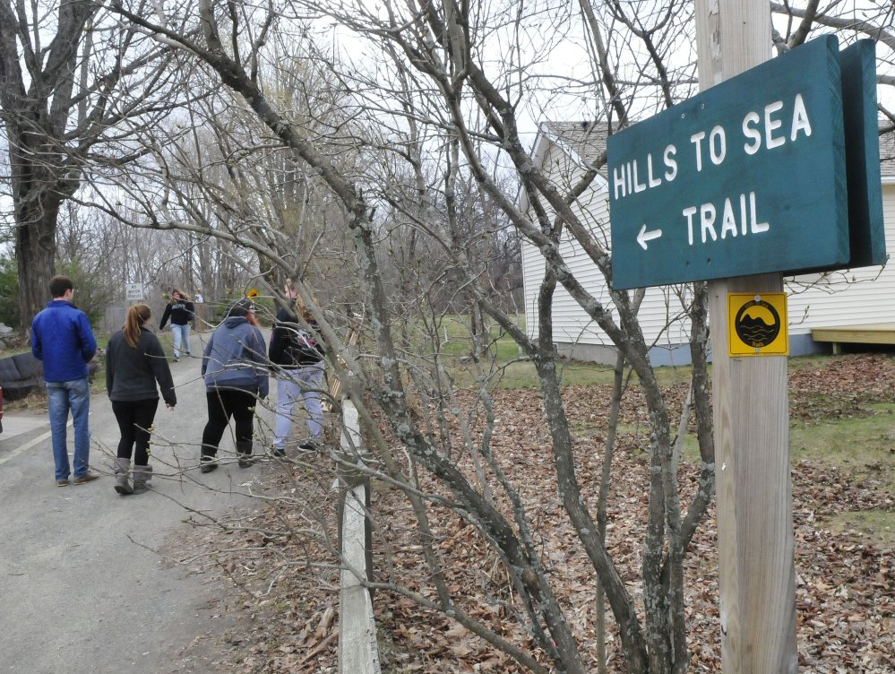 Walkers use the Hills-to-Sea Trail on Tuesday near the beginning of the 47-mile path from Unity to Belfast. The trail system's grand opening is scheduled for National trails Day, June 3.