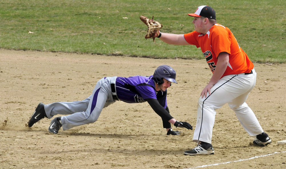 Winslow's Andrew Bolduc waits for the ball during a pick-off attempt on  Waterville's Cody Pellerin on Wednesday in Waterville.