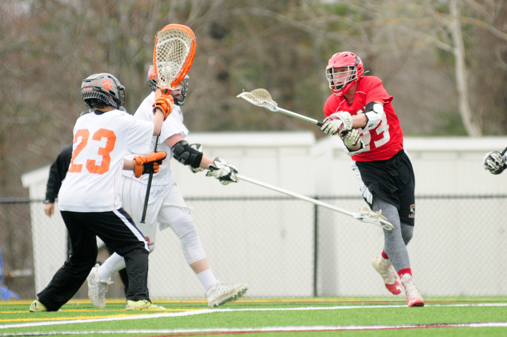 Cony's Nick Robinson scores on Gardiner keeper Noah Keene during a Kennebec Valley Athletic Conference Class B game Thursday at Lincoln Academy in Newcastle.