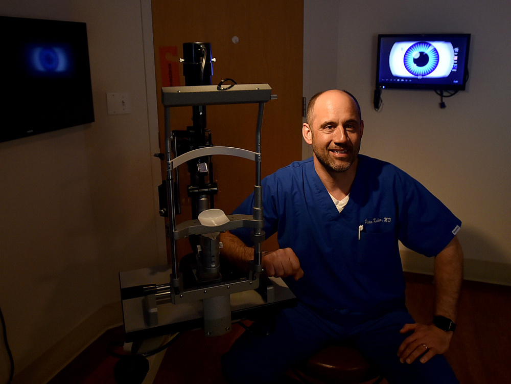 Dr. Peter Kohler poses April 11 in his examination room at Eye Care of Maine in Waterville. The practice has been named the 2016 Business of the Year by the Mid-Maine Chamber of Commerce.