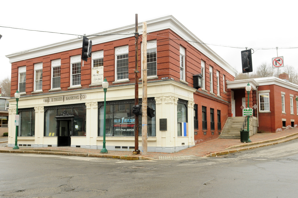 This Friday photo shows 192 Water St. in Gardiner where the former bank building is being converted into a Domino's Pizza.