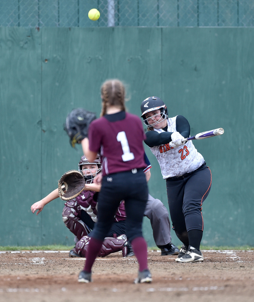 Winslow's Bailey Robbins (23) makes contact on a pitch from Nokomis' Brittany Bubar (1) on Thursday in Winslow.