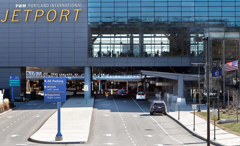 The suit seeks records from about how any travel ban may have been carried out in six international airports in New England, including the Portland International Jetport.
