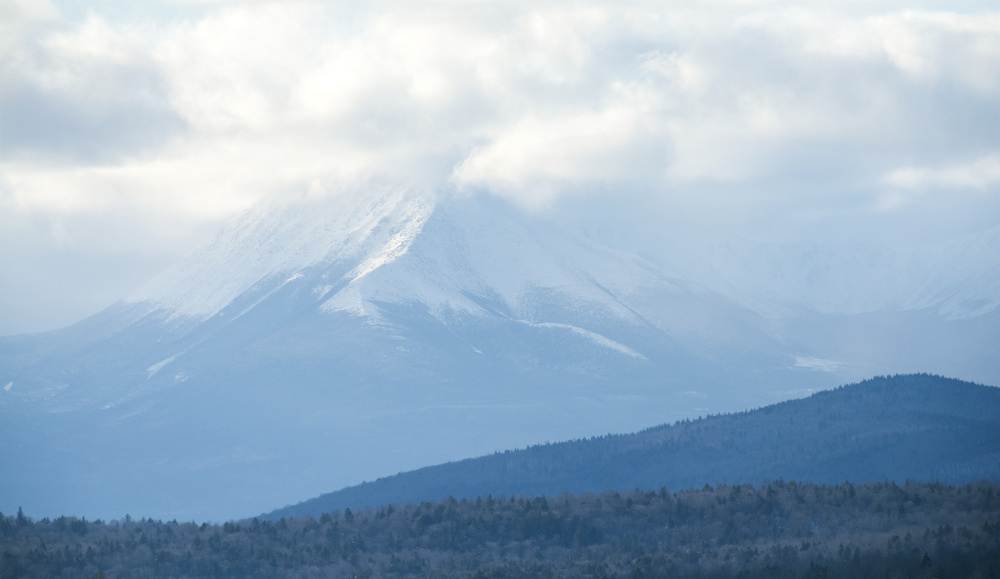 Snow and clouds obscure the peak of Mt. Katahdin in Baxter State Park, which borders the new Katahdin Woods and Waters National Monument. Three of the four members of Maine's congressional delegation want the monument designation to stand to avoid reopening a divisive debate in towns surrounding the property, but the governor wants it to be rescinded.