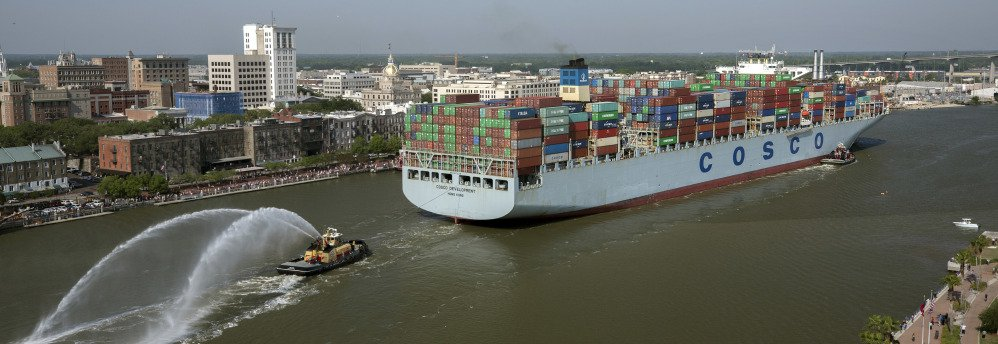 The container ship COSCO Development sails up river past the historic district of Savannah, Ga., to the Port of Savannah on Thursday.