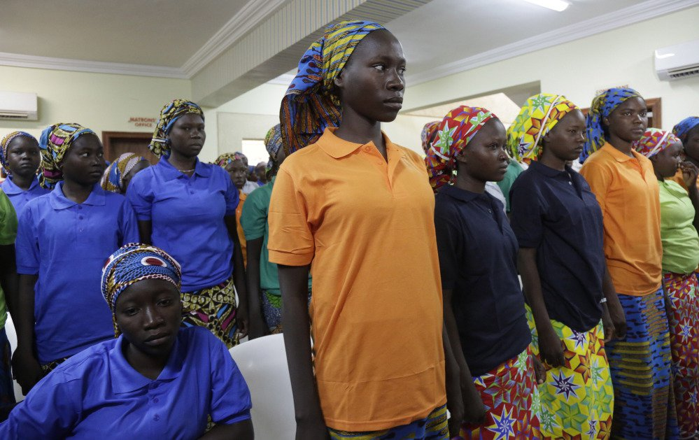 Chibok schoolgirls, recently freed from Nigeria extremist group Boko Haram captivity, are photographed in Abuja, Nigeria, earlier this week.