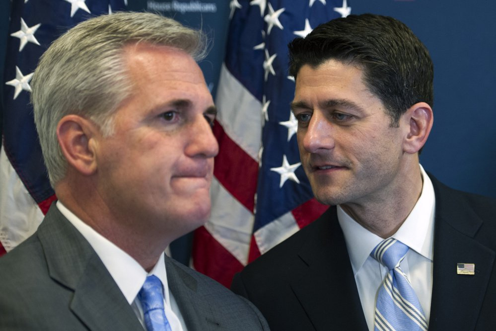 House Speaker Paul Ryan of Wisconsin, right, speaks with House Majority Leader Kevin McCarthy of California in November 2016. In a June 15, 2016, conversation, McCarthy makes an apparent joke about the Russian president paying then-candidate Donald Trump.