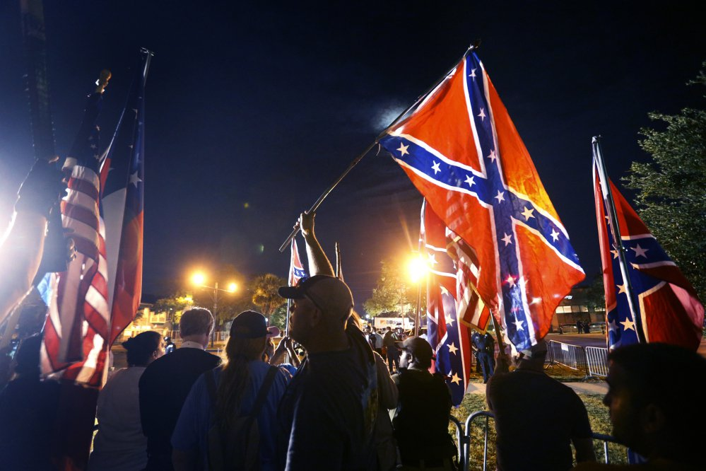 Demonstrators who supports keeping Confederate era monuments protest before the Jefferson Davis statue was taken down in New Orleans, Thursday, May 11, 2017. (AP Photo/Gerald Herbert)