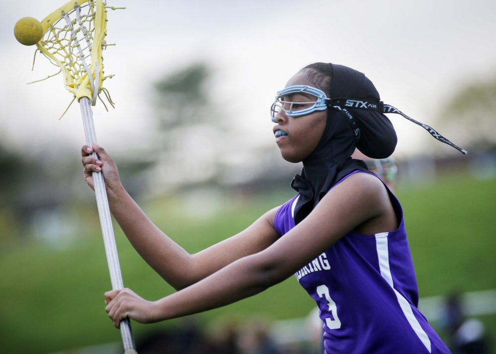 Fadumo Adan, a lacrosse player at Deering High, wears a sports hijab provided by the school.