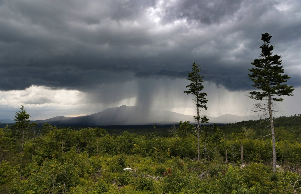 A rainstorm passes over Mount Katahdin in this 2015 view from land that is now the Katahdin Woods and Waters National Monument.