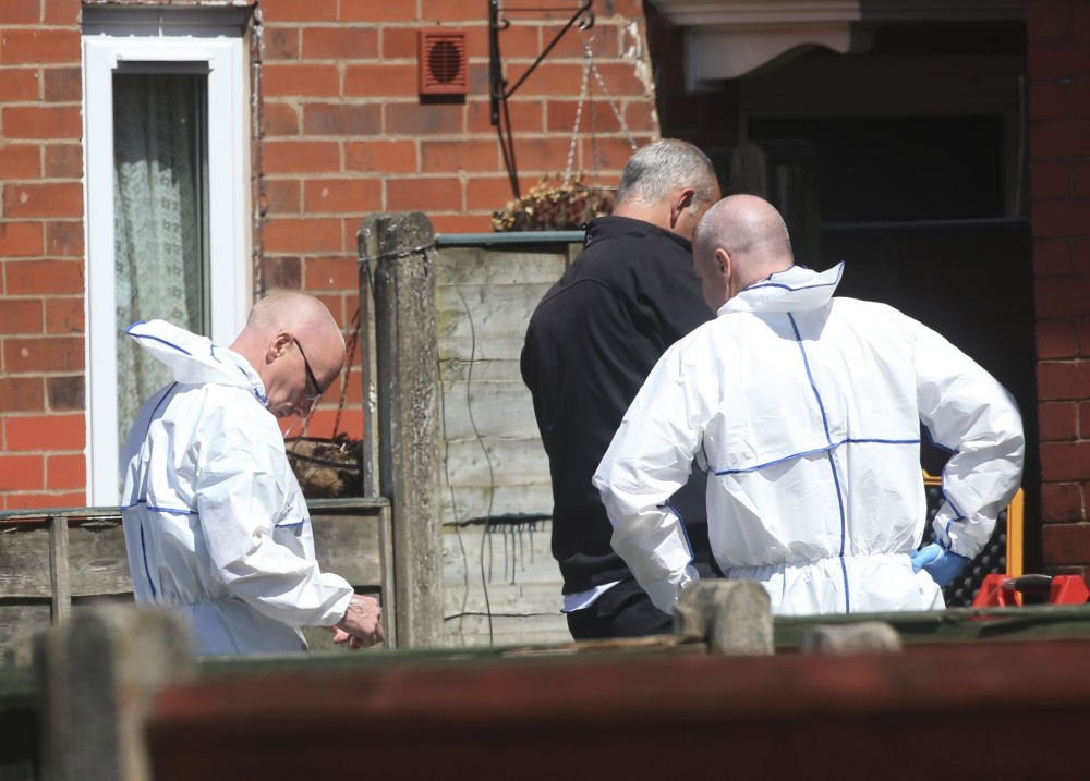 Police forensic investigators search the property of Salman Abedi on Tuesday in connection with the explosion that took place Monday at the Manchester Arena, in Greater Manchester, England.