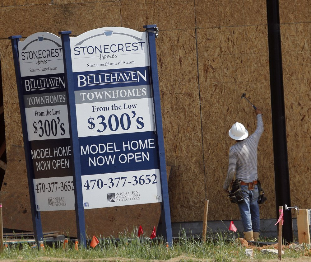 A carpenter works on a home being built in Woodstock, Ga. Some economists viewed the April drop in new-home sales as a one-month blip, expecting a rebound in May.