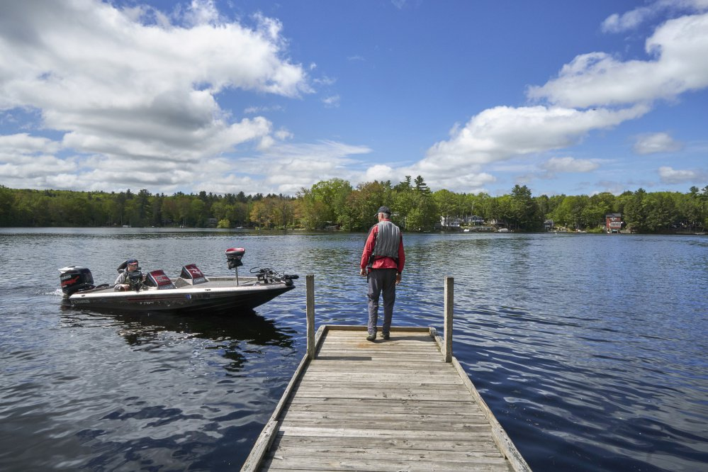 Chris Lloyd pulls in his boat to pick up his father, Don Lloyd, at the Mousam Lake launch in Shapleigh on Saturday, where a nice start to Memorial Day weekend had vessels out in number.