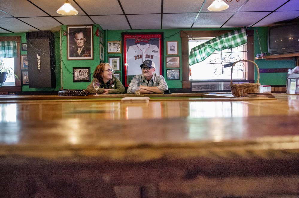 Matthew and Susan Robbins of South Portland have a drink at the bar on Friday.  Staff photo by Derek Davis