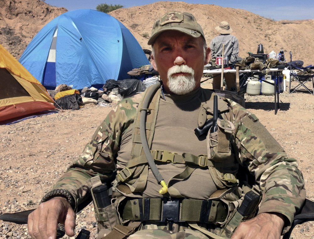 Gerald DeLemus of Rochester, N.H. sits on Cliven Bundy's ranch near in Nevada. DeLemus was sentenced to more than 7 years in federal prison. Associated Press/Ken Ritter