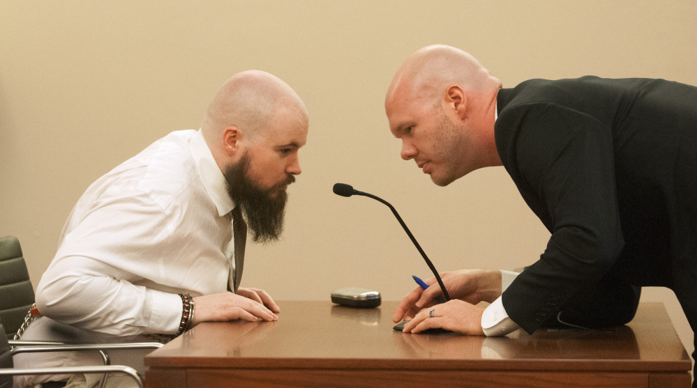 Leroy Smith III, left, confers with defense attorney Scott Hess Jan. 20 at Capital Judicial Center in Augusta during a hearing on Smith's mental competence to tried for murder, in connection with the slaying and dismembering of his father in May 2014.