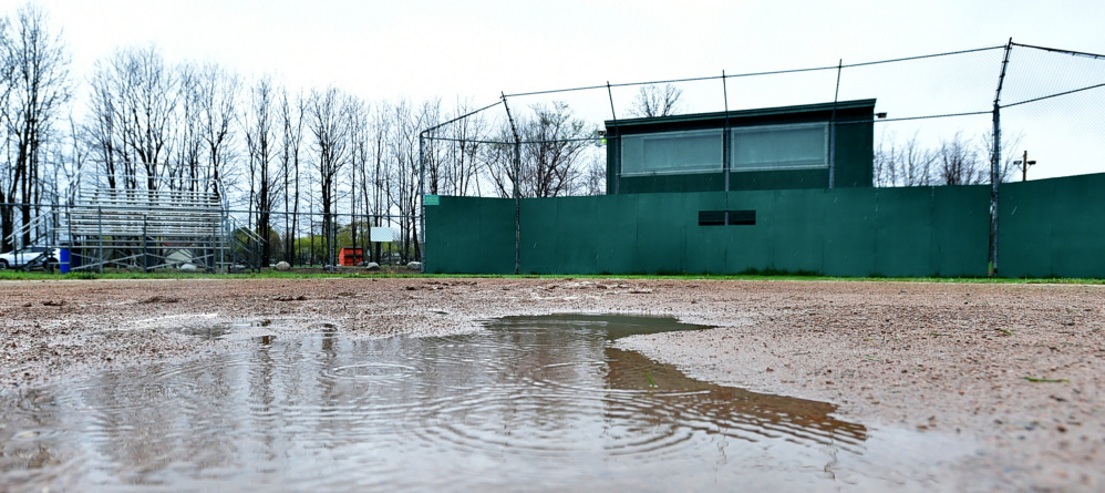 Mud and a puddle occupy home plate on the baseball field at Winslow High School.