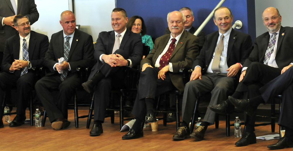 Thomas College and area business officials listen Wednesday at the college as Greg Powell, chairman of the Alfond Foundation, announces that the college would receive $5.3 million for the new Harold Alfond Institute of Business Innovation. From left are Mike Duguay, Rick Bryant, Chris Guance, David Flanagan, Bill Alfond and Conrad Ayotte.