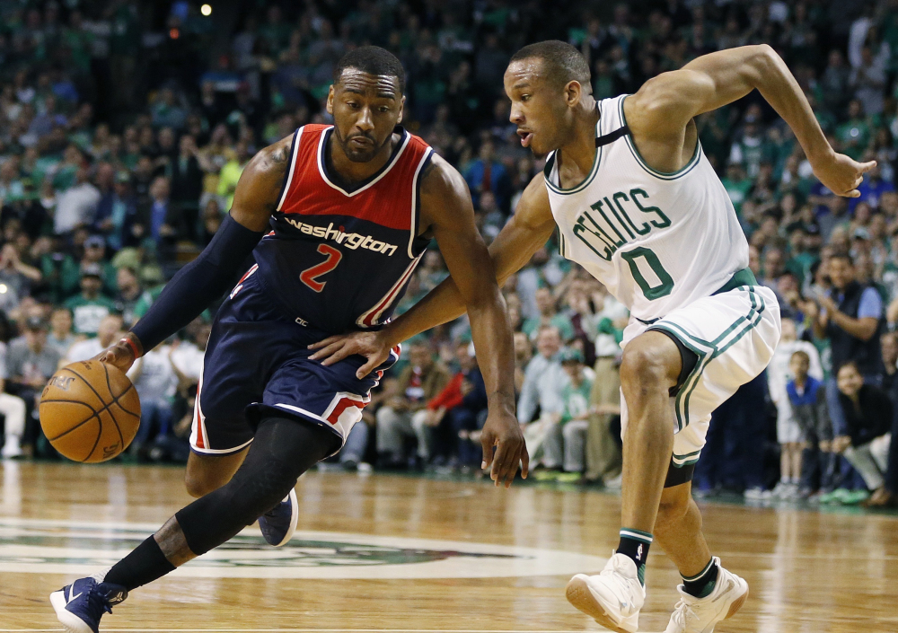Washington star John Wall, left, drives against Boston Celtics guard Avery Bradley during the third quarter of Game 1 of a second-round series on April 30.