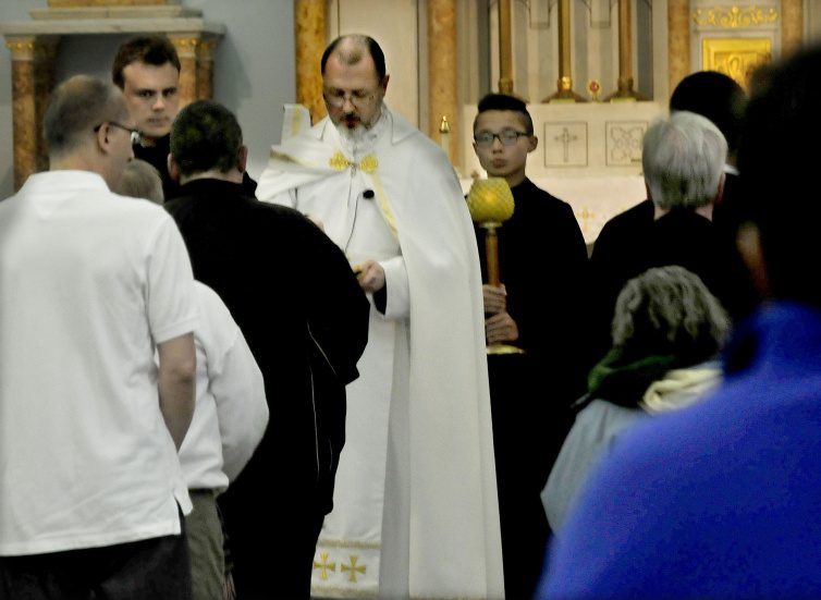 The Rev. James Doran conducts a Mass for nearly 70 parishioners Sunday at the St. Joseph Maronite Catholic Church in Waterville. Doran has taken over since Rev. Larry Jenson was recently removed over allegations of sexual exploitation of a minor 15 years ago.